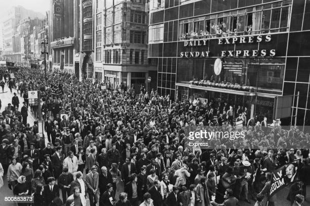 Marchers pass the Daily Express Building in Fleet Street on their way to St Paul's Cathedral to pay tribute to assassinated American civil rights...