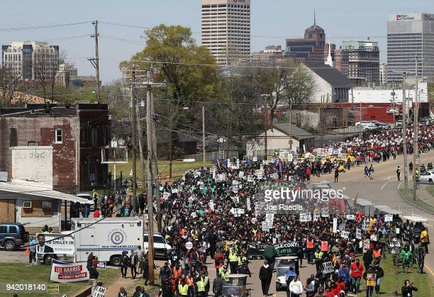 Marchers pass through the street during an event to mark the 50th anniversary of Dr Martin Luther King Jr's assassination April 4 2018 in Memphis...