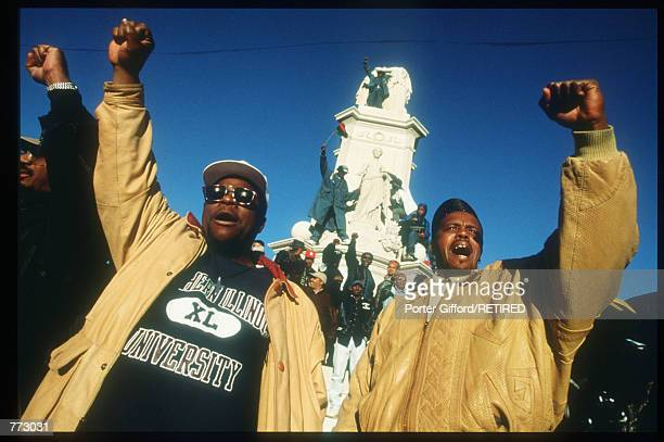 Marchers raise their fists at the Million Man March October 16, 1995 in Washington, DC. The purpose of the march was to galvanize men to respect...