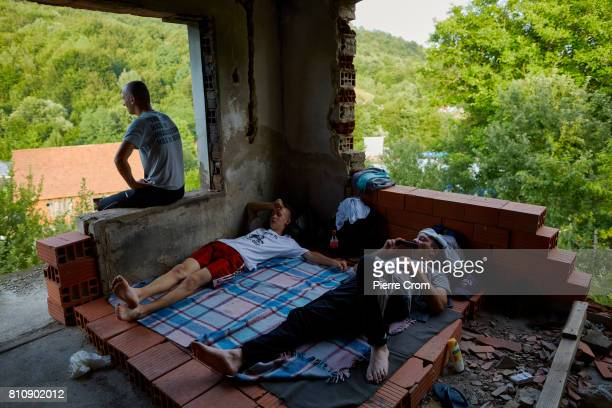 Marchers rest in an abandoned building on July 8 2017 in Zvornik Bosnia and Herzegovina The building was destroyed during the 199295 Bosnian war...