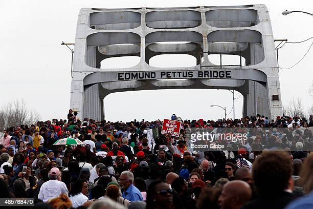 Marchers retrace the steps of those who marched with Dr. Martin Luther King, Jr. 50 years ago over the Edmund Pettus Bridge in Selma, AL.