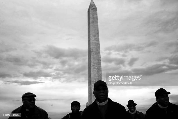 Marchers silently walk from the Dr Martin Luther King Jr Memorial to the National Mall to mark the 50th anniversary of King's assassination April 4...