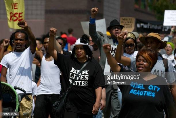 Marchers walk through the Homewood neighborhood during their Black Brilliance Collective March and Gathering August 19 2017 in Pittsburgh...