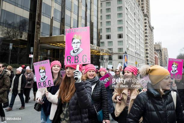 """Marchers with a signs that says """"Notorious R.B.G"""" with a picture of Ruth Bader Ginsberg Associate Justice of the U.S. Supreme Court as a rap icon..."""