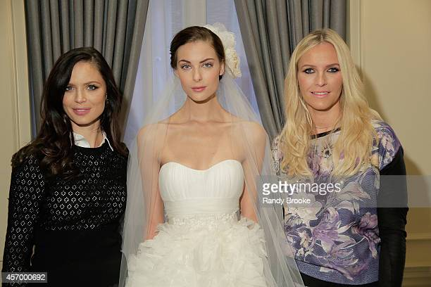 Marchesa designers Georgina Chapman and Keren Craig pose after the presentation with a model wearing one of their latest Bridal looks on October 10...