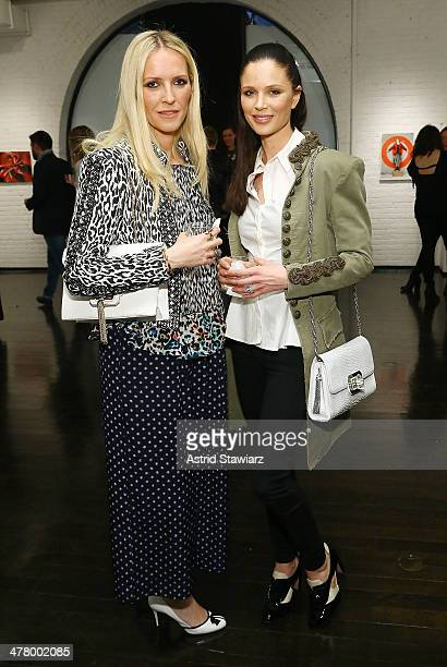 Marchesa designers Keren Craig and Georgina Chapman attend Vs/Better Charity Art Exhibition opening reception at Dillon Gallery on March 11 2014 in...