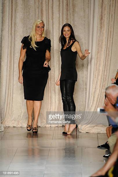 Marchesa designers Keren Craig and Georgina Chapman walk the runway at the Marchesa Spring 2013 fashion show during mercedes-Benz Fashion Week at...