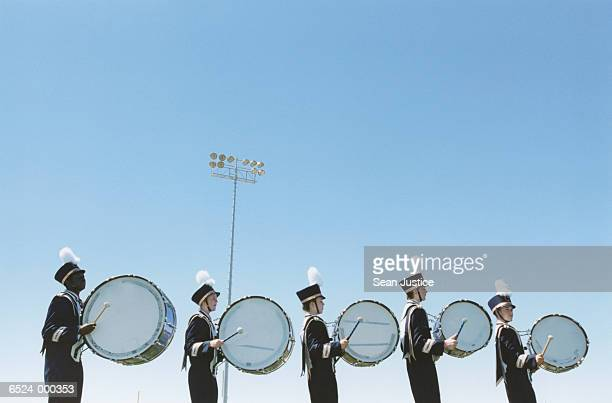 marching band drummers in row - marching band stock pictures, royalty-free photos & images