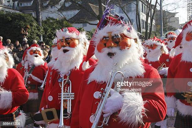 Marching band in Santa costume playing trumpet