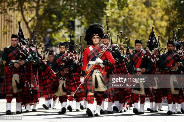 Marching band make their way down Elizabeth Street during the ANZAC Day parade on April 25, 2021 in Sydney, Australia. Anzac day is a national...