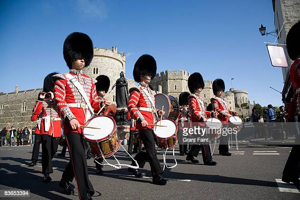 marching band marching near castle - windsor castle stock pictures, royalty-free photos & images