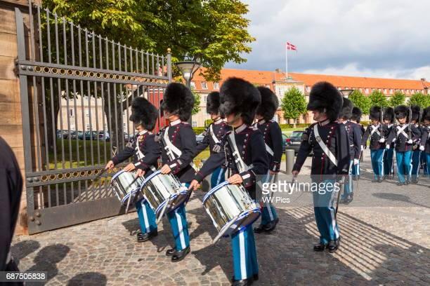 Marching band of soldiers leaving barracks at Rosenborg Castle, Copenhagen, Denmark.