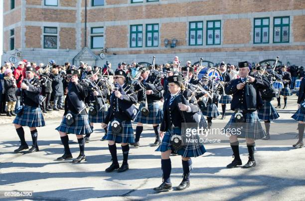 Marching Band of the Chicago Police with Bagpipes and drums at the Quebec St-Patrick's Parade