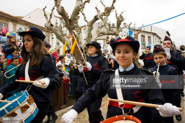 A marching band parades in the main street during the carnival procession in the mountain town of Coja