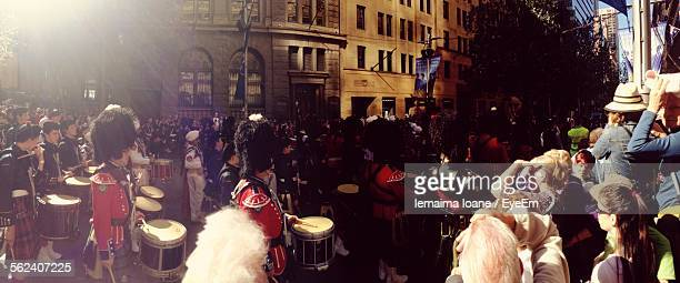 Marching Band Performing In City Street