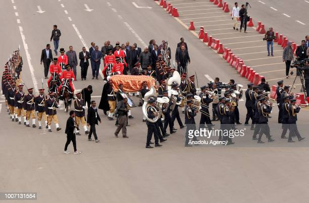 A marching band play as a funeral procession transporting the coffin of Engineer Simegnew Bekele the project manager for a hydroelectric dam since...
