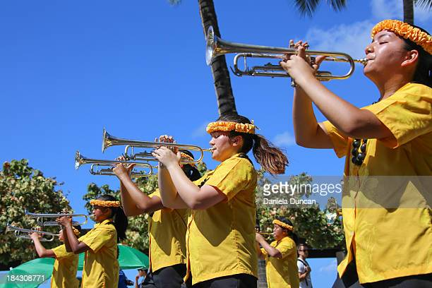 Marching band playing at the Flower Parade in Oahu, during the Aloha Festivals.