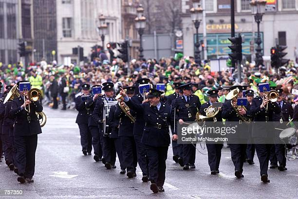 A marching band plays as crowds gather to watch the St Patrick's Day parade March 17 2002 in Dublin Ireland Wet weather failed to stop thousands from...