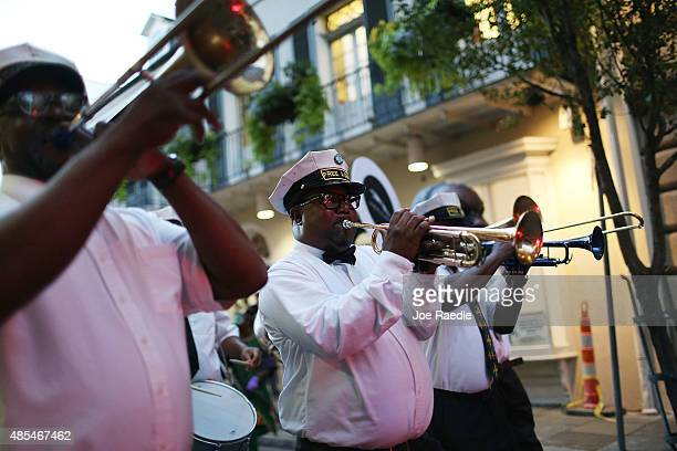 A marching band winds through the streets of the French Quarter on August 27 2015 in New Orleans Louisiana Tourists have returned as the town...