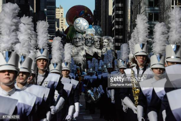 A marching band with a float depicting Mount Rushmore is seen on on 6th Ave during the annual Macy's Thanksgiving Day parade on November 23 2017 in...