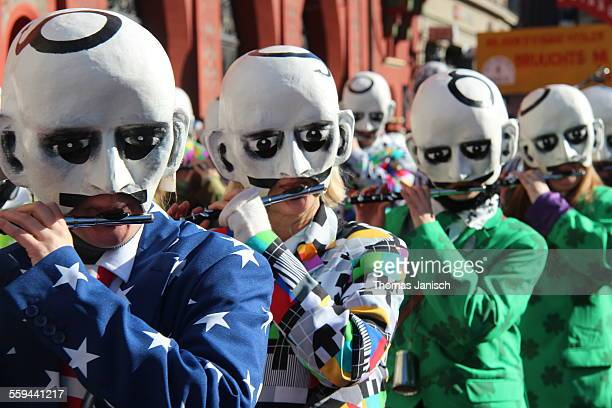 Marching band with masks and costumes playing piccolo flutes Carneval of Basle Switzerland