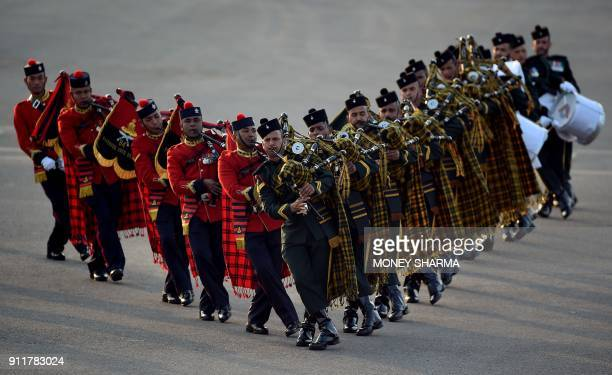 TOPSHOT Marching bands from the Indian armed forces perform during the Beating Retreat ceremony in New Delhi on January 29 2018 The military ceremony...