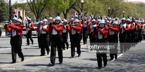 Marching Bands perform during the '2018 National Cherry Blossom Festival Parade' in Washington United States on April 14 2018