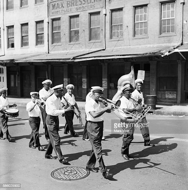 A marching brass band in a New Orleans parade