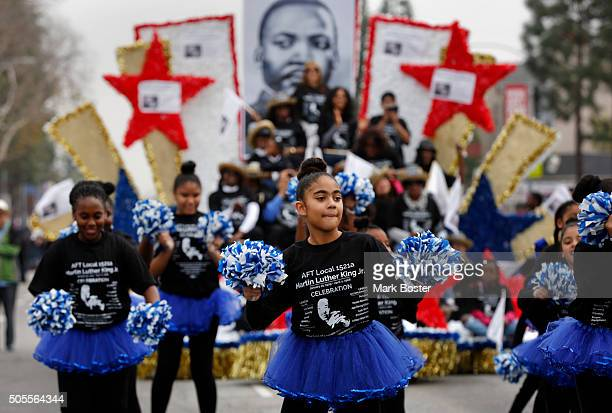 Marching groups and drill teams like the one from the AFT Local 1521a dance their way down the route along Martin Luther King Blvd during the 31st...