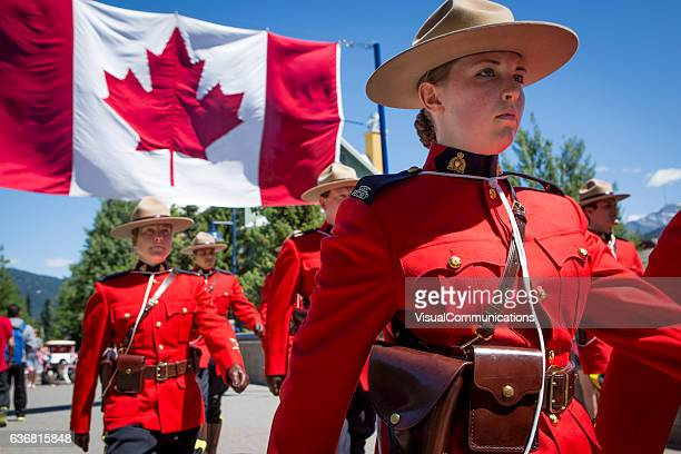rcmp marching in canada day parade. - canada day stock pictures, royalty-free photos & images