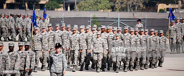 marching in formation at air force bmt coin ceremony - marching stock pictures, royalty-free photos & images