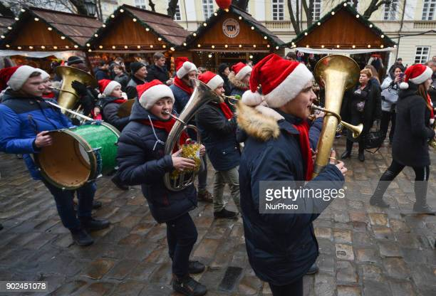 A marching music band plays Christmas melodies at the Rynek Square on Orthodox Christmas Day On Sunday 7 January 2018 in Lviv Ukraine