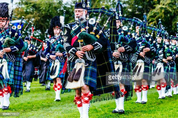 marching scottish pipe band - kilt stock photos and pictures