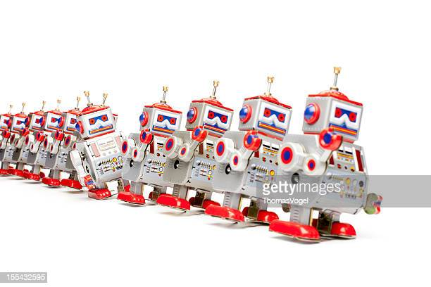 marching tin toy robots - wind up toy stock photos and pictures