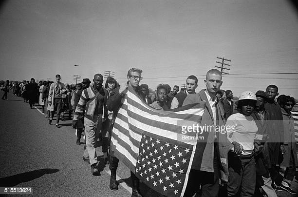 Marching to Montgomery Selma Ala Civil rights marchers carry an American flag upside down in the international distress signal as they participate in...