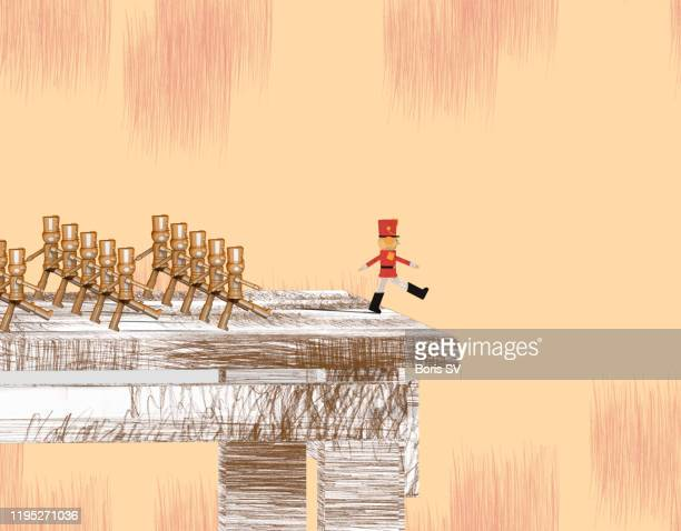 marching toy soldiers - wrong way stock pictures, royalty-free photos & images