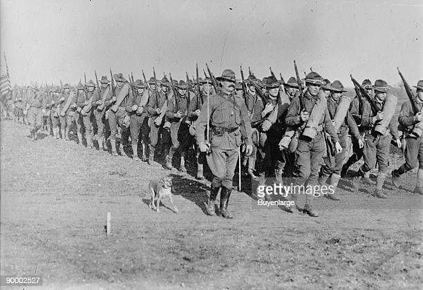 Marching US Infantry in Texas is massed for the Mexican Border Campaign but a mascot dog is near the head of the column The US was prepared to enter...