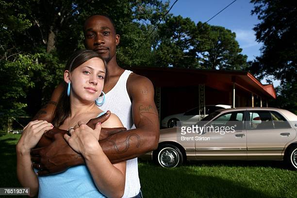 Marci and Chris Johnson an interracial couple August 7 2007 in Jena Louisiana They are the parents of a 19 month old son and complain of repeated...