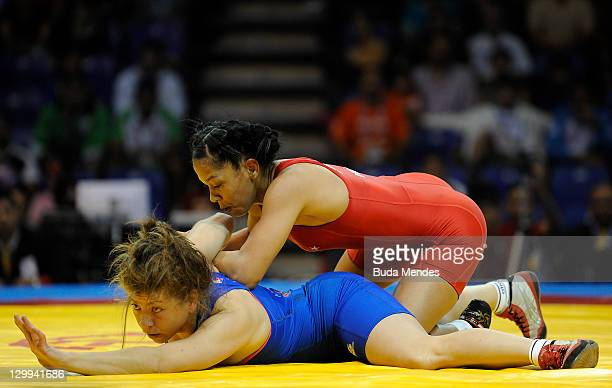 Marcia Andrades of Venezuela fights against Alma Valencia of Mexico in the Women's Freestyle 55kg during the Pan American Games Guadalajara 2011 at...
