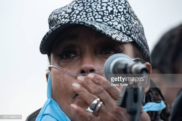 Marcia CarterPatterson speaks during a vigil for her son Manuel Ellis a black man whose March death while in Tacoma Police custody was recently found...
