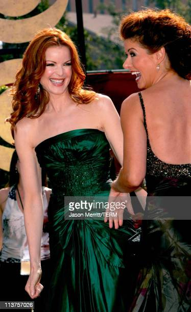 Marcia Cross and Debra Messing during 57th Annual Primetime Emmy Awards Arrivals at The Shrine in Los Angeles California United States