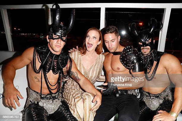 Marcia Cross and the dancer from club Pacha attend the Remus Lifestyle Night 2016 on August 4 2016 in Palma de Mallorca Spain