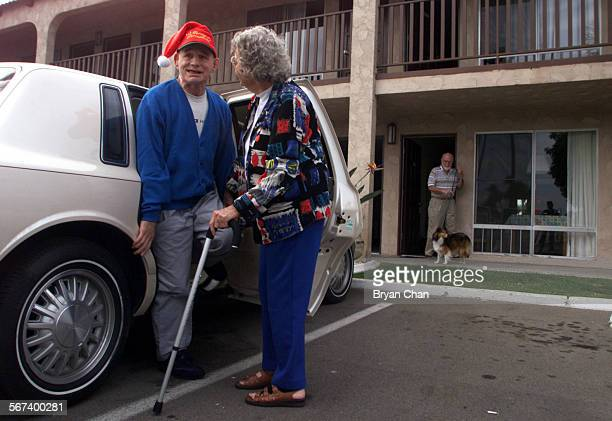 Marcia Flannery arrives with her son Page Dye left who is develomentally disabled at their Costa Mesa hotel room At right is her husband Mike...