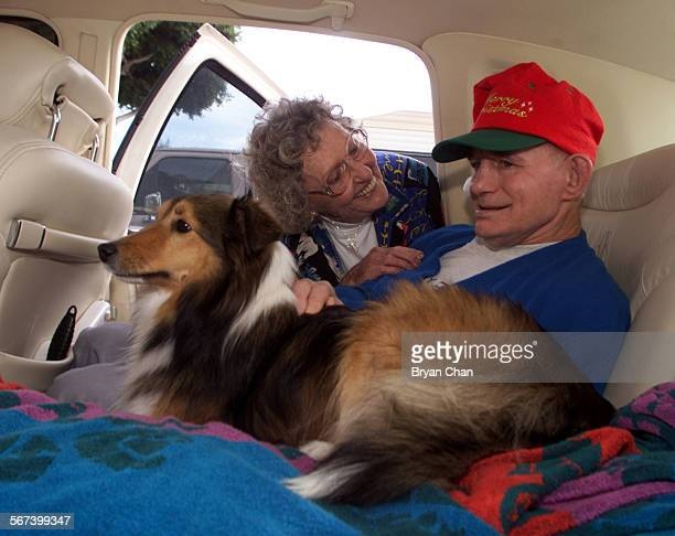 Marcia Flannery tries to coax a response from her son Page Dye as he pets their dog Mollie while picking him upfrom his residence at the Fairview...