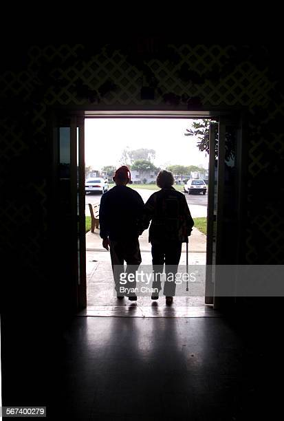 Marcia Flannery walks with her son Page Dye who is develomentally disabled out of the Fairview Developmental Center She and her husband Mike spent...