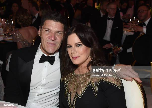 Marcia Gay Harden and Greg Calejo attend the 27th annual Elton John AIDS Foundation Academy Awards Viewing Party sponsored by IMDb and Neuro Drinks...