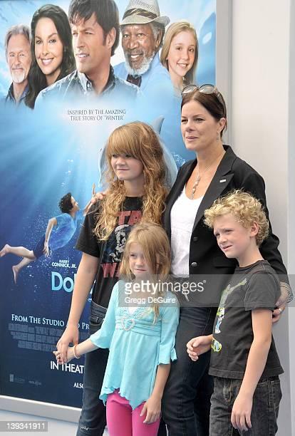 Marcia Gay Harden daughter Eulala Scheel twins Julitta Scheel and Hudson Scheel arrive at the World Premiere of Dolphin Tale at the Village Theatre...
