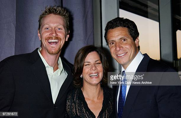 Marcia Gay Harden is flanked by her husband writer Thaddaeus Scheel and Andrew Cuomo at the People's Campaign Summer Gala a fundraiser for Cuomo's...