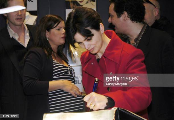 Marcia Gay Harden watches as Karen Duffy writes in Montblanc's Great American Love Story. The book, when finished, will hold the record for including...