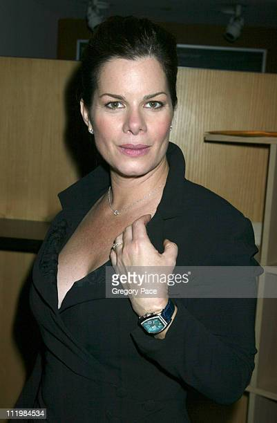 Marcia Gay Harden wearing a Nicole Miller dress and a Elini watch